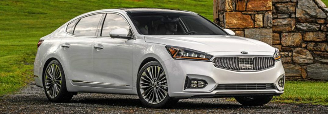 2018 Kia Cadenza in white sitting on a gravel driveway