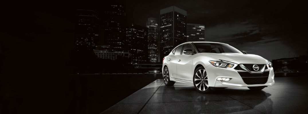 Front View of Pearl White 2018 Nissan Maxima against dark urban background