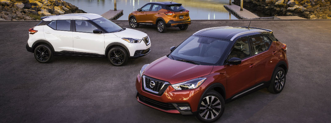 2018 Nissan Kick models in red, orange, and white