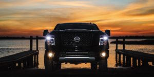 2018 Nissan TITAN Front View of Black Exterior with sunset background