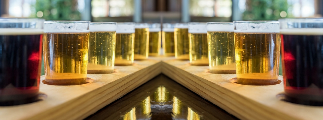 Mirrored Image of a Flight of Beers