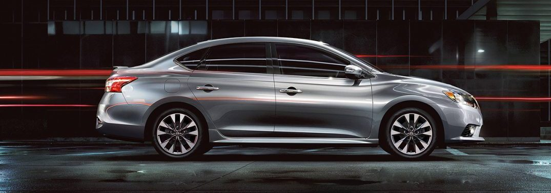 2018 Nissan Sentra side profile in front of a dark background with red lights streaking past