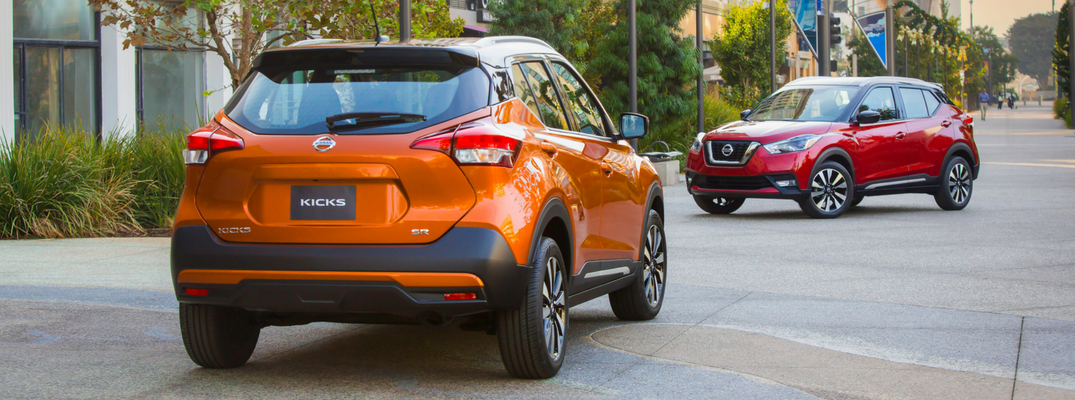 2018 Nissan Kicks Rear View of Orange Exterior and Front View of Red Exterior