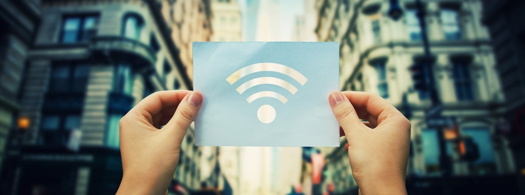 Woman Holding up Card with WiFi Symbol