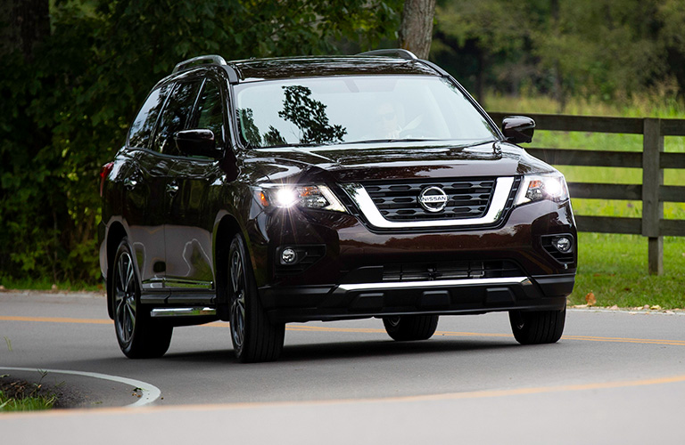 2019 Nissan Pathfinder Front View of Black Model with Headlights On