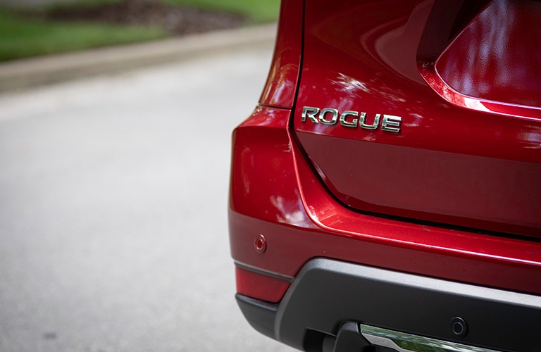 "Close-up on the ""Rogue"" emblem on the back of the 2019 Nissan Rogue."