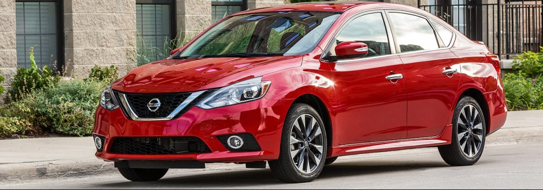 Red 2019 Nissan Sentra on a city street. Exterior side angled front view.
