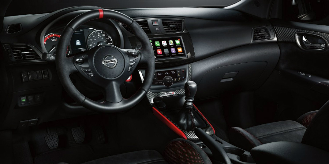 The sleek black and red accented interior of a 2019 Nissan Sentra NISMO.