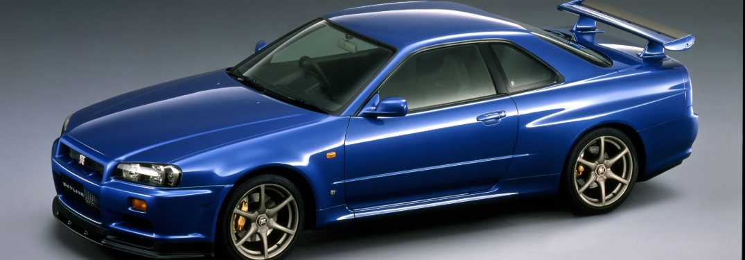 blue 1998 nissan skyline with wing