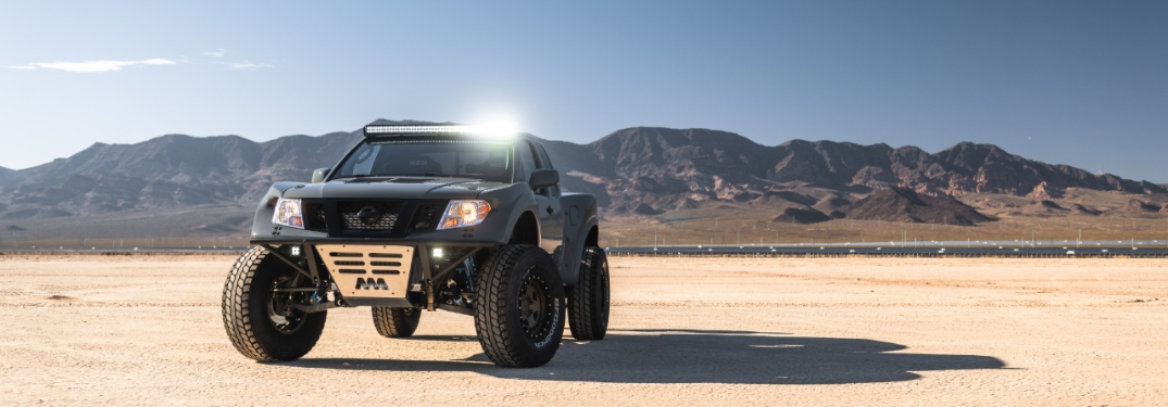 nissan frontier desert runner in the desert with overhead lights on
