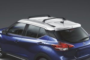 Blue 2020 Nissan Kicks showing white roof from exterior drivers side rear