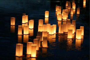 Floating lanterns in water at night