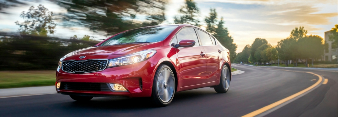 2018 kia forte currant red driving