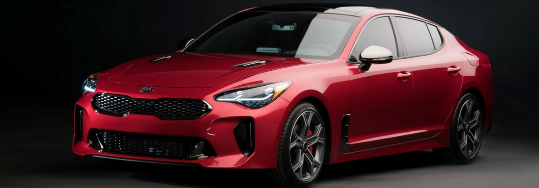 2018 kia stinger full view close up in hichroma red