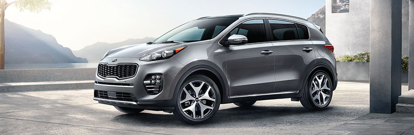 Exterior view of a gray 2019 Kia Sportage parked under an overpass