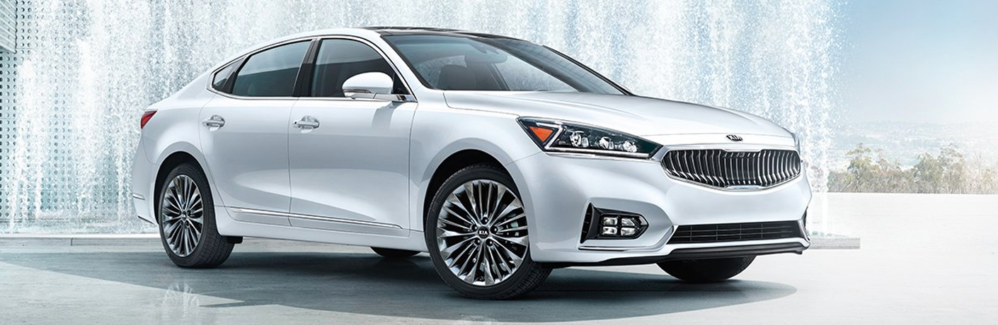 Exterior view of white 2019 Kia Cadenza parked in front of a water fountain