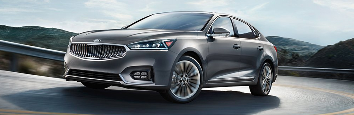 Exterior view of a gray 2019 Kia Cadenza driving down a highway