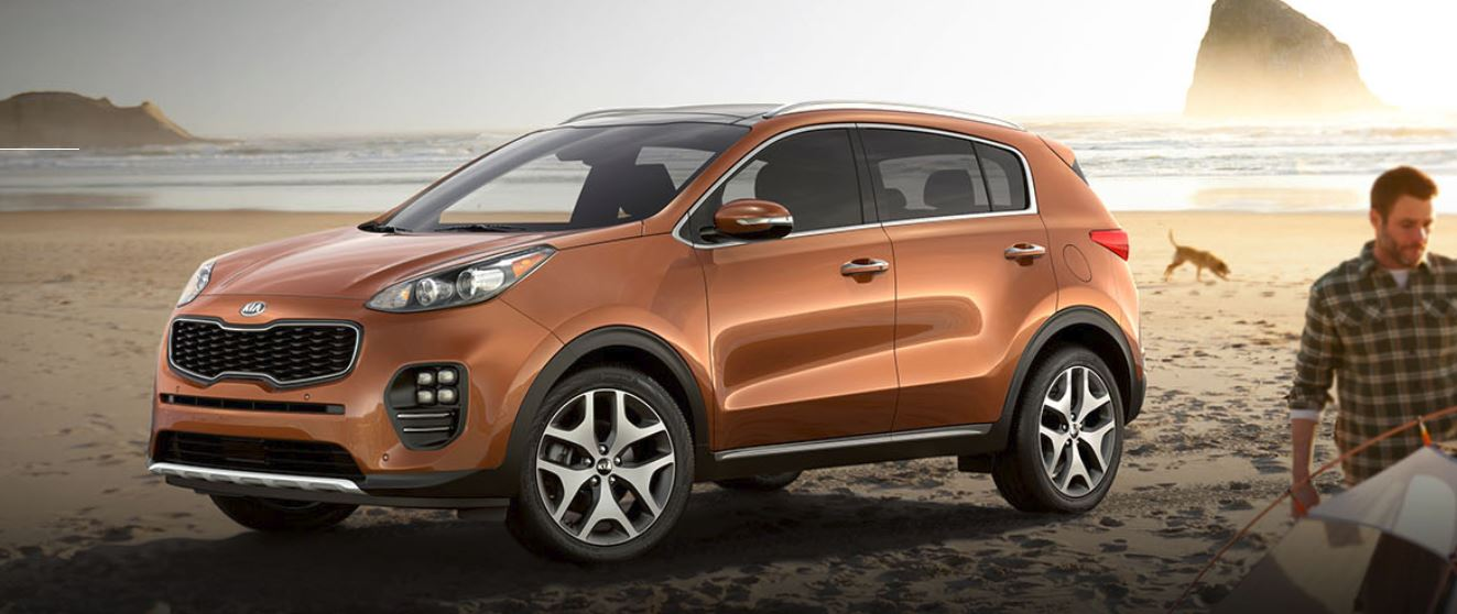 Bronze Kia Sportage on beach