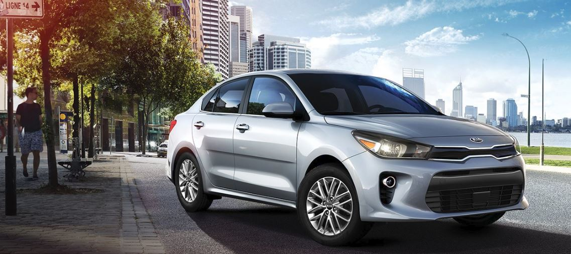 Silver 2018 Kia Rio with City Background
