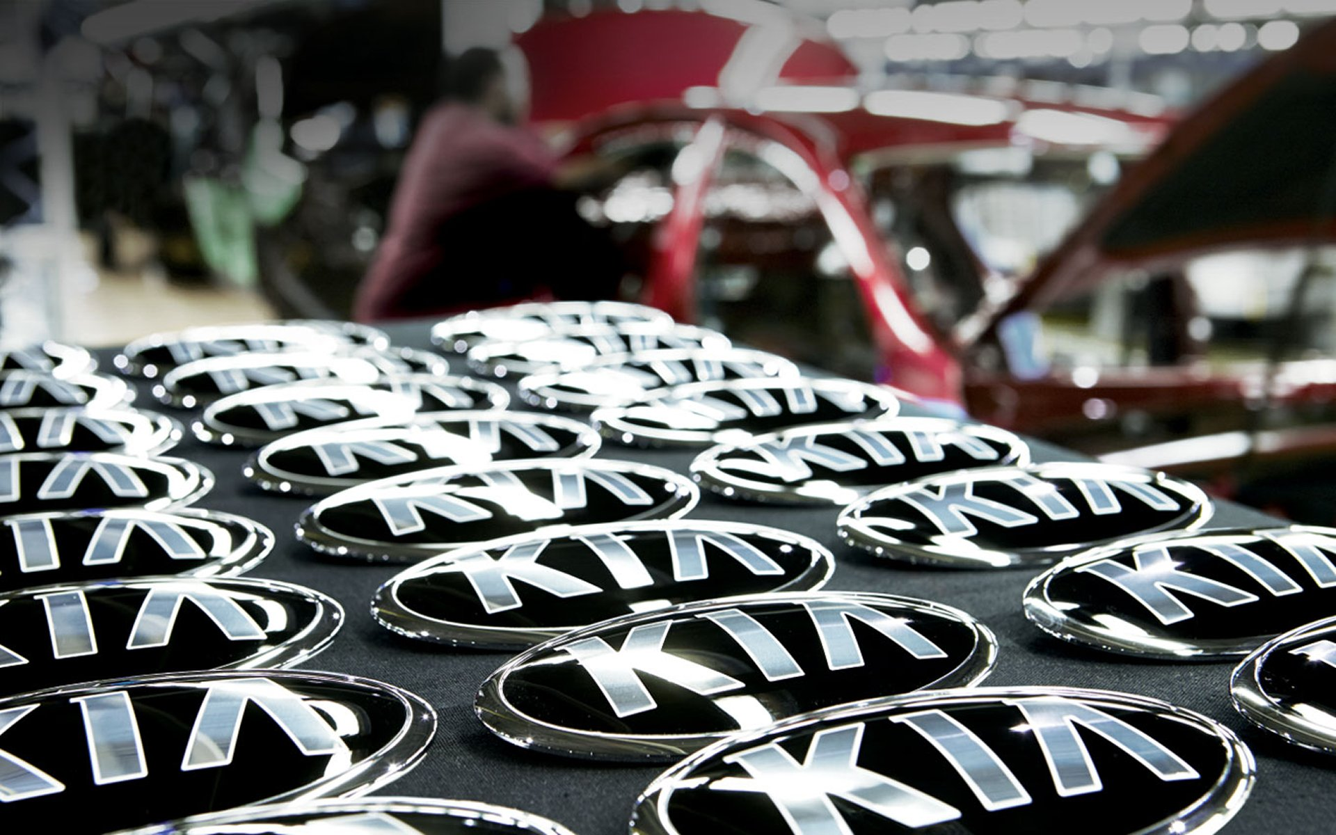 Kia Emblems displayed in factory setting