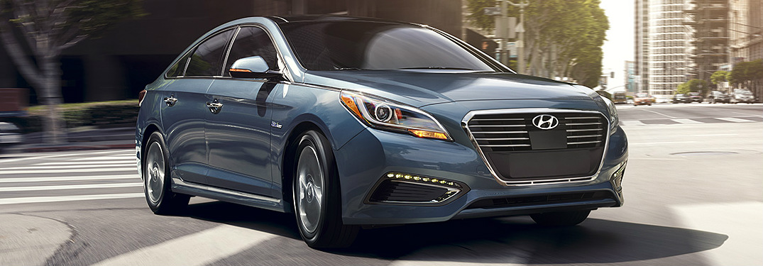 2017 Hyundai Sonata Hybrid blue side view turning