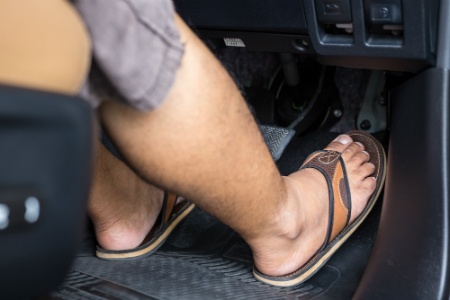 wearing a pair of flips flops while driving