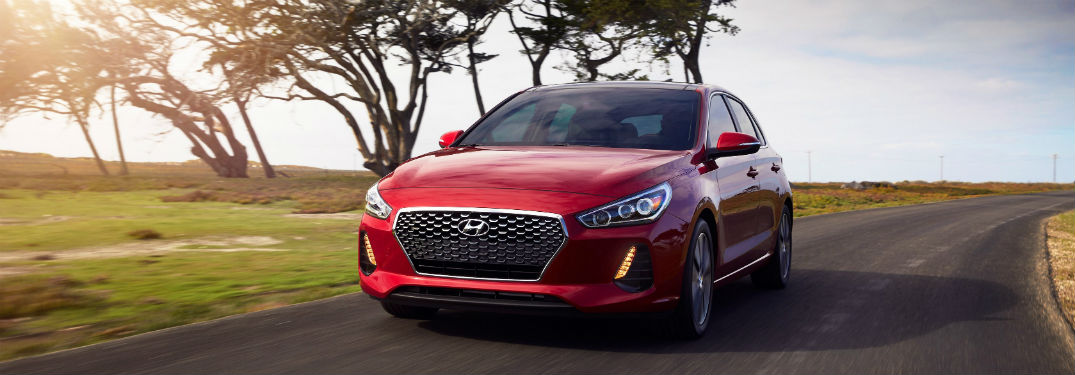 red 2018 Hyundai Elantra GT driving toward the camera