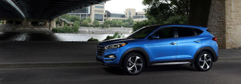 side view of a blue 2018 Hyundai Tucson