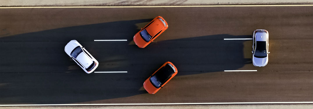aerial view of four 2019 Hyundai Veloster models on a track
