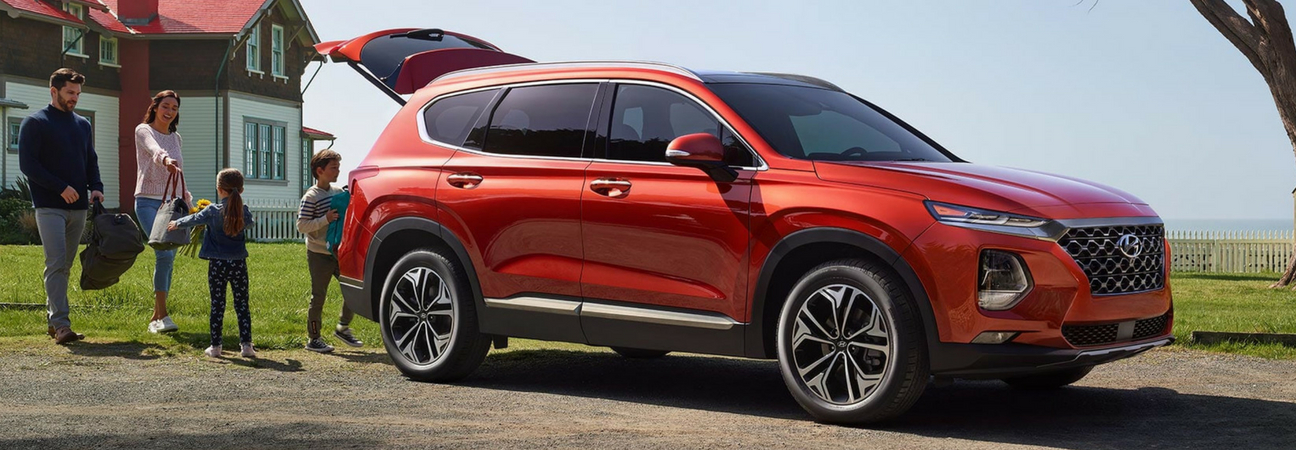 Family loading bags into red 2019 Hyundai Santa Fe