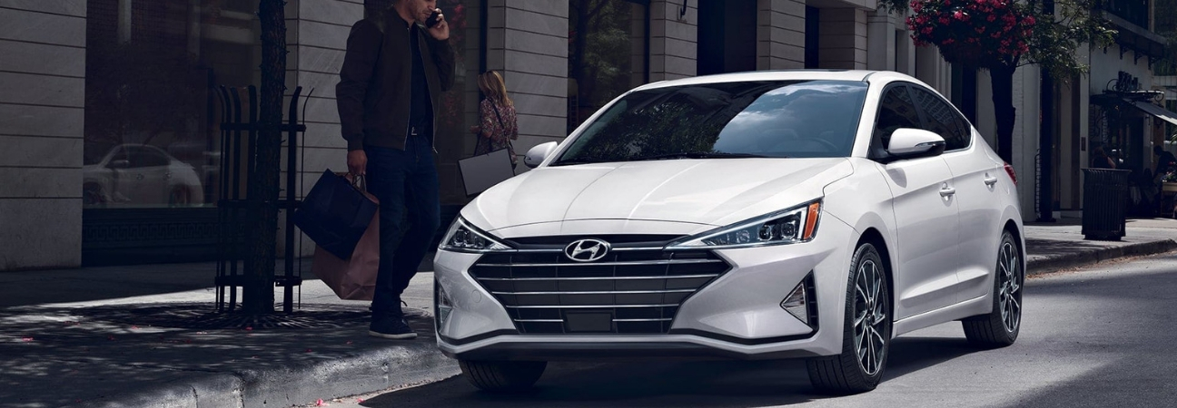White 2019 Hyundai Elantra parked curbside in the city