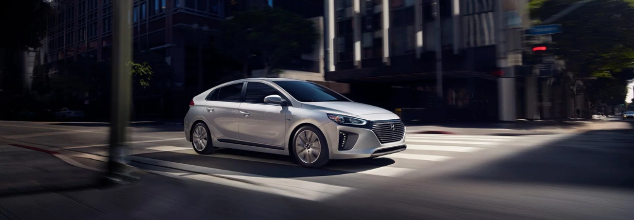 Silver 2019 Hyundai IONIQ driving through intersection