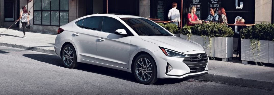 2019 Hyundai Elantra white side view at a cafe
