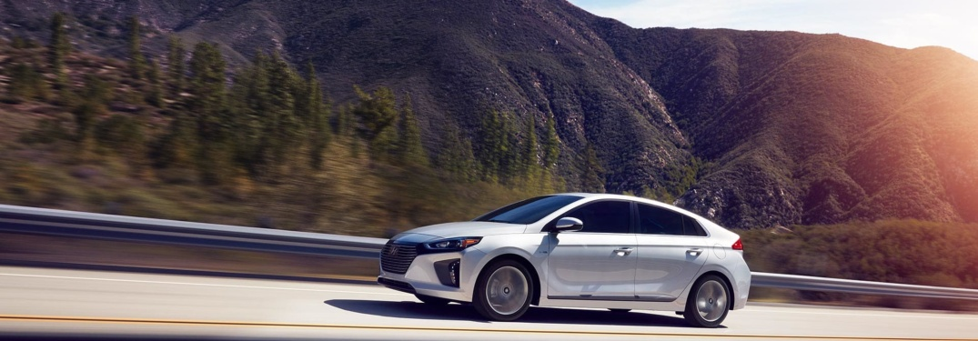 2019 Hyundai Ioniq Hybrid white side view in the mountains