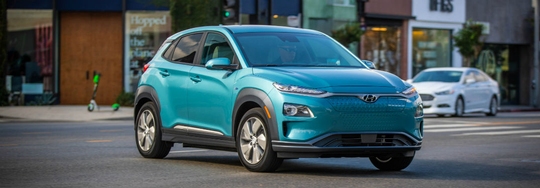 2019 Hyundai Kona EV exterior front fascia and passenger side on town road