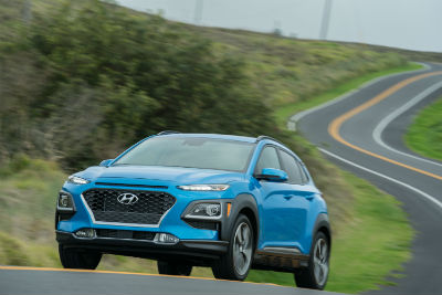 2019 Hyundai Kona exterior front fascia and drivers side on road with grass