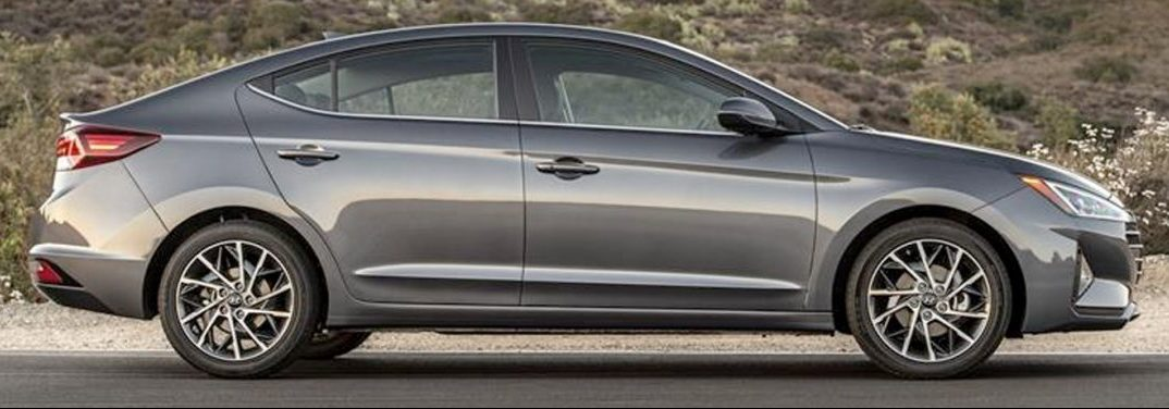 Grey 2019 Hyundai Elantra exterior side-view on a country road.