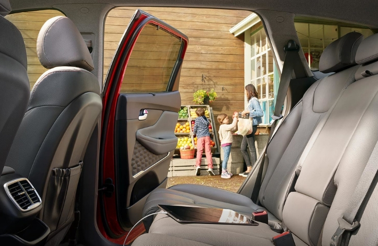 2019 Hyundai Santa Fe Rear Seat with Family in Background