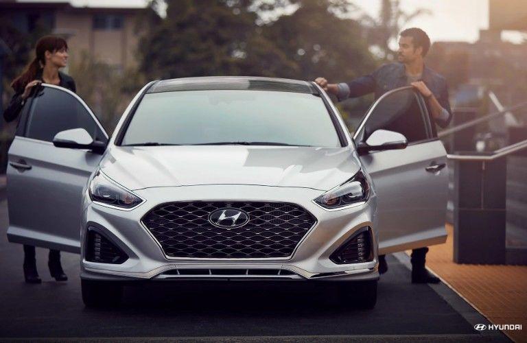 Two people entering 2019 Hyundai Sonata