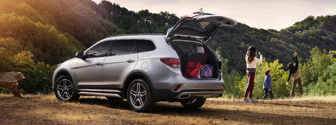 2019 Hyundai Santa Fe XL exterior shot with circuit silver paint color parked in the wilderness on a dirt hill with trunk open showcasing cargo capacity