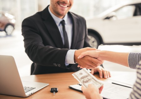 Dealer Shaking Hands with Customer