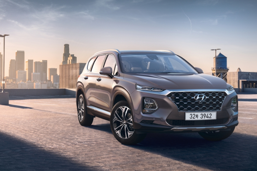 Gray 2020 Hyundai Santa Fe from front passenger view with city skyline in background