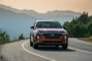 Red 2020 Hyundai Santa Fe from front view with mountains in background