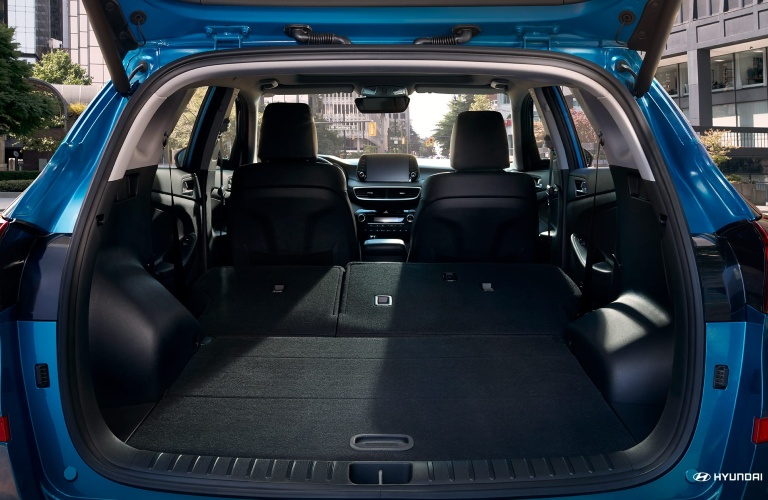 Gaping cargo maw of a blue 2020 Hyundai Tucson.