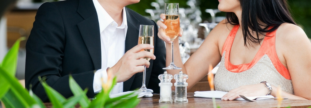 couple dining together drinking wine