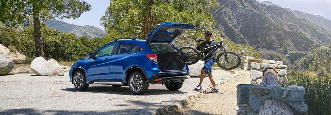 Man putting a bicycle in a 2019 Honda HR-V