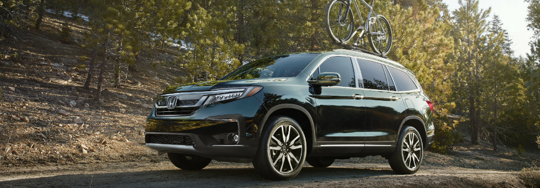 2019 honda pilot driving with bike on roof