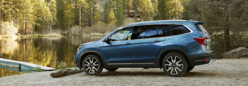2019 honda pilot side view by water