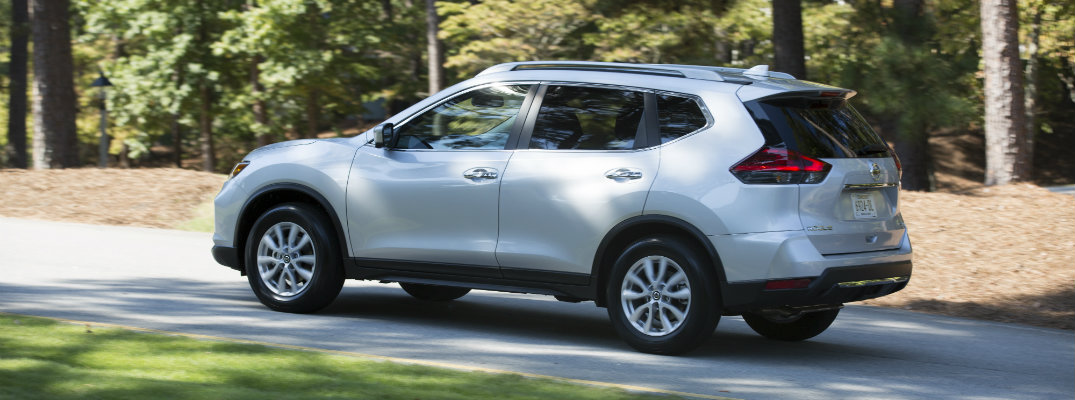 2018 Nissan Rogue driving down the road
