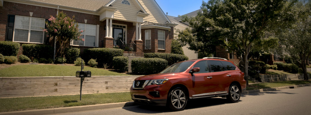 2018 Nissan Pathfinder side view of red exterior